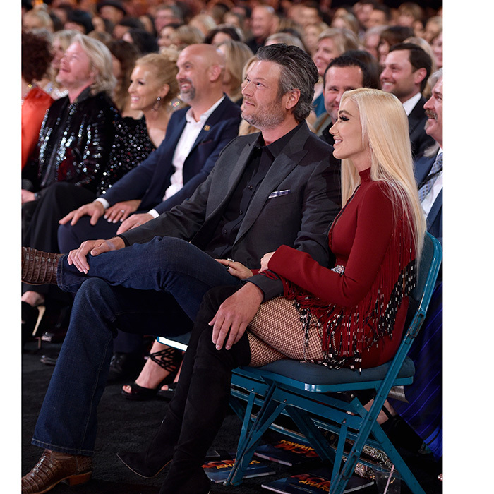 In the audience Blake Shelton stayed close to Gwen with his hand draped over her leg during the proceedings. The No Doubt singer was sizzling as usual in a fringed mini-dress and thigh-high boots. 