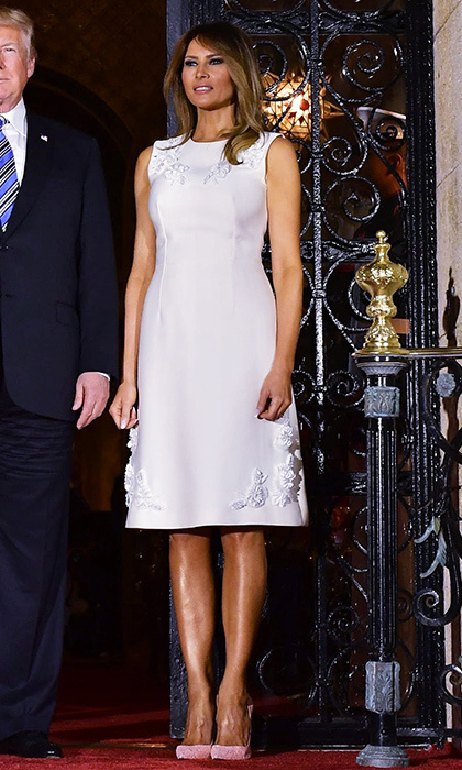 For dinner at Mar-a-Lago on April 18, the first lady opted for spring pastels. Melania wore a tailored pale rose sheath dress with white floral embellishment along with shoes in a deeper shade of pink.