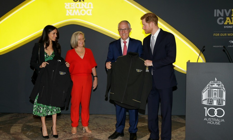 Days later, Prince Harry and Meghan Markle attended yet another event together. The couple received a fun gift on Saturday, April 21, while attending the special 2018 Invictus Games reception: matching jackets! The Invictus logo jackets are in honor of the upcoming sporting event in Sydney, and are from Australia's first couple Prime Minister Malcolm Turnball and Lucy Turnball.