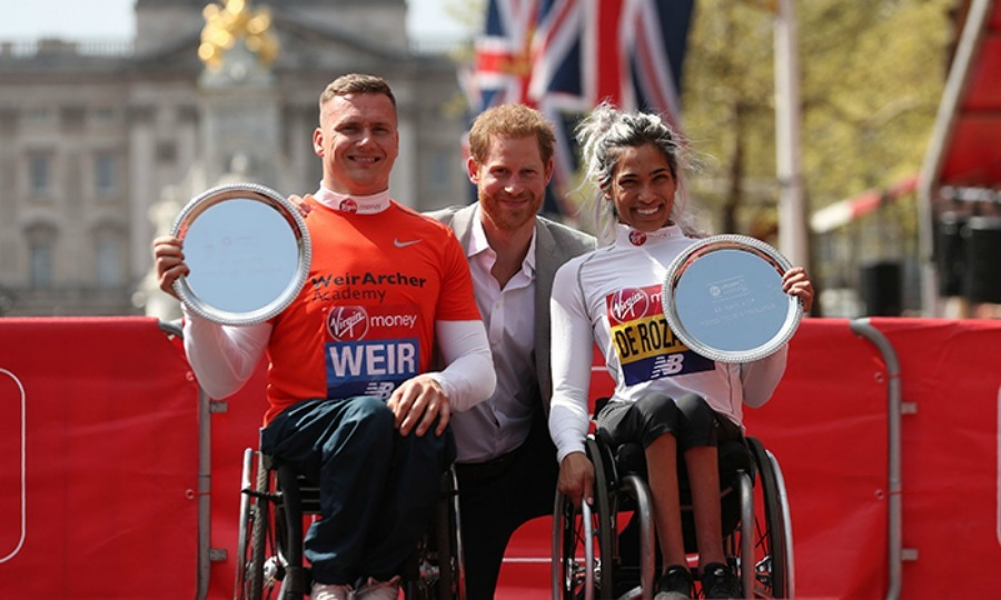 Prince Harry also happily posed with wheelchair winners David Weir, from Britain, and Australia's Madison de Rozario. He looked dapper in an open-collared white shirt and grey jacket.
