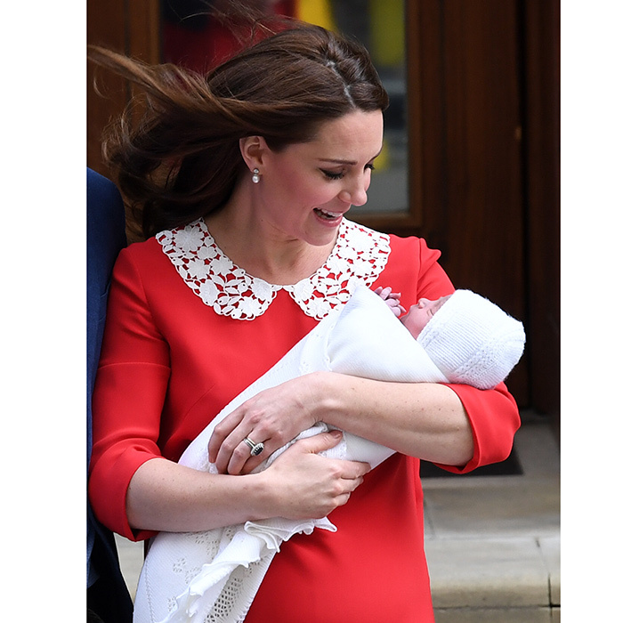 Wearing a Jenny Packham dress – she's worn the designer for every time she's left the Lindo Wing for all three of her babies – Kate looked adoringly at her little boy.
