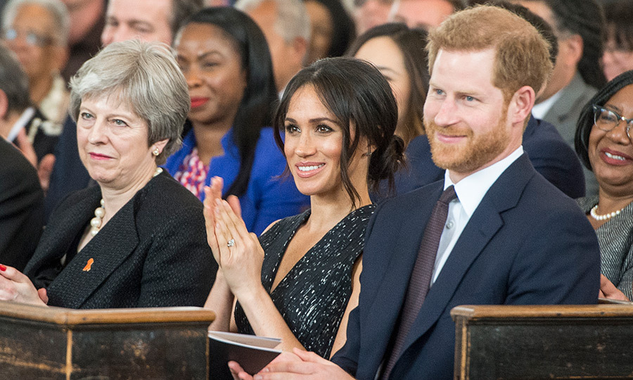 Inside the church, Meghan was seated between her fiancé Prince Harry and British Prime Minster Theresa May. 