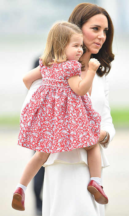 During her first royal tour in Poland, Charlotte touched down in Warsaw wearing a red Liberty dress with Mary Janes. While the designer was unknown, the British royal did wear hand-me-down shoes from Prince Harry.