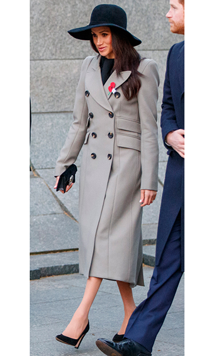 Meghan had an early start on April 25, attending a service at dawn to commemorate Anzac Day, which honors Australia's and New Zealand's lost veterans. The royal bride-to-be joined Prince Harry at 5am at Wellington Arch, Hyde Park Corner, dressed in a full-length grey coat by Canadian brand Smythe and Sarah Flint high heel shoes. The actress accessorized with a clutch, wide-brimmed hat and traditional poppy pin. 