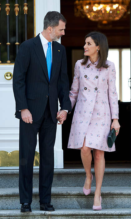 King Felipe VI of Spain and Queen Letizia held hands as they welcomed President of Mexico Enrique Pena Nieto and his wife Angelica Rivera to their home, the Zarzuela Palace in Madrid, on April 25.