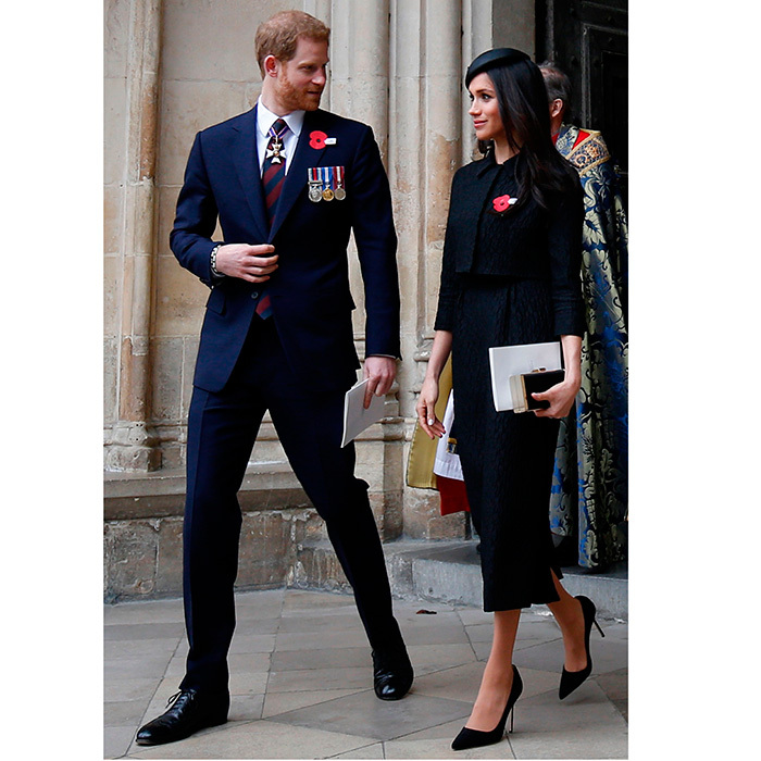 Britain's Prince Harry and Meghan are seen wearing their matching dark suits and red poppies as they leave Westminster Abbey following the service of commemoration and thanksgiving to mark Anzac Day.