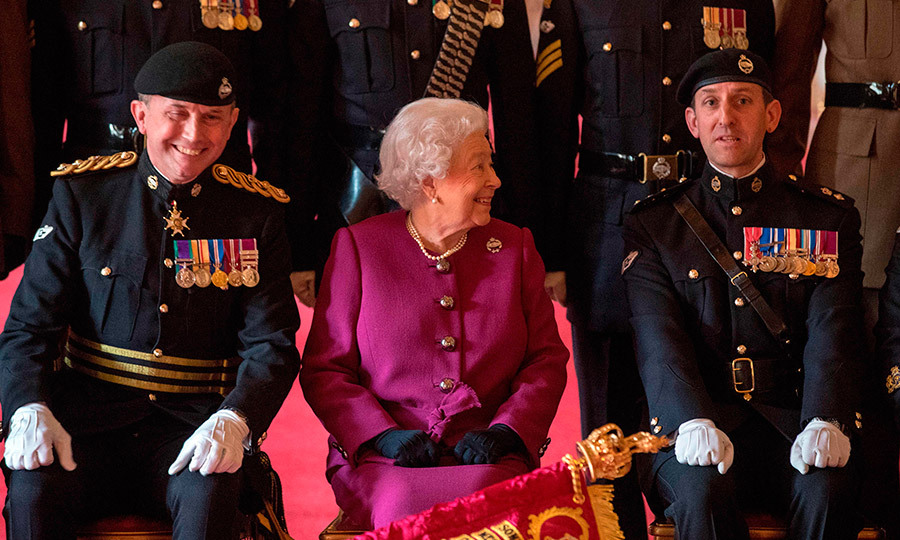 There's nothing more irresistible than Queen Elizabeth's smile! The Queen, who is the Colonel-in-Chief of the Royal Tank Regiment, looked like she was charming the troops during a portrait shoot after presenting the soldiers with their new standard in St George's Hall at Windsor Castle on April 25.