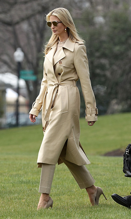 Ivanka looked like she was taking a page from her stepmother Melania Trump's style book as she walked across the South Lawn of the White House on March 29, 2018. The businesswoman wore three of Melania's wardrobe staples: movie star shades, a trench coat and sky-high stilettos.