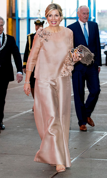 On April 16, Queen Maxima again displayed her exuberant style in a pale pink wide-legged ensemble with floral details. The royal was attending the premiere of the musical <I>The Color Purple</I> in Amsterdam. 