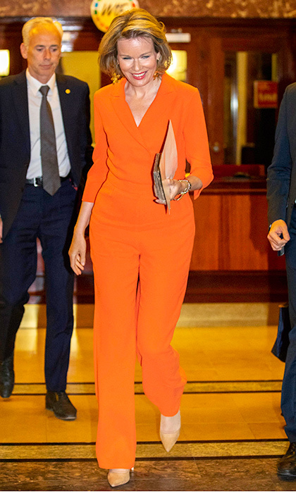 Things were looking bright for Queen Mathilde of Belgium, who wore this electric orange jumpsuit to a gathering at the Catholic University in Leuven, Belgium on April 17.