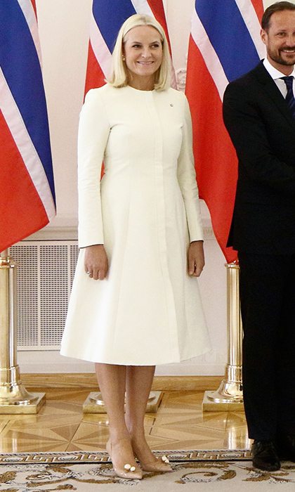 Norway's Crown Princess Mette-Marit, who drew comparisons to Queen Elsa during Prince William and Duchess Kate's visit to her country, chose another wintry white look for a meeting with Lithuanian President Dalia Grybauskaite at the presidential palace in Vilnius, Lithuania on April 24.
