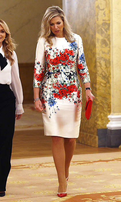 Queen Máxima of the Netherlands was ready for spring in a white day dress with floral print for lunch at The Noordeinde Palace in The Hague.