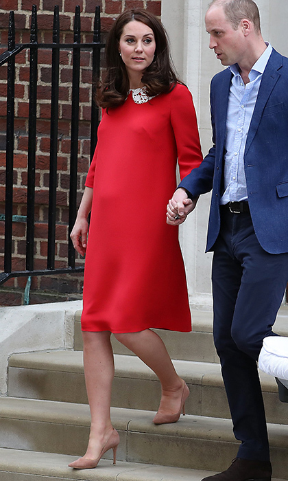 Just seven hours after giving birth to Prince Louis, the Duchess of Cambridge was looking picture perfect in a red dress with white lace collar by Jenny Packham. 