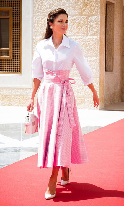 Queen Rania of Jordan was pretty in pink at Al Husseiniya Palace, chaneling sweet 1950s style in a pink empire-waisted skirt and crisp white blouse.