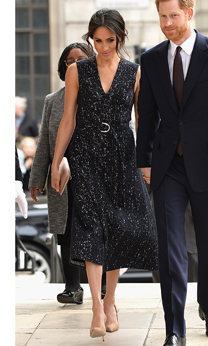 For a service in honor of the late Stephen Lawrence, Meghan Markle wore a navy and silver dress by BOSS with nude high heel shoes and neutral clutch. 
