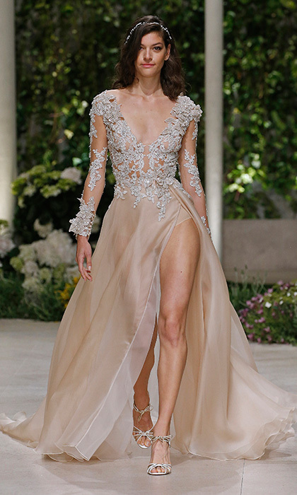 Popular global fashion brand Pronovias was packed with signature glamour for their Barcelona Bridal Week 2018 show. Here's the 'Cindy', a lingerie-inspired look with embroidered bodice and sheer nude skirt.