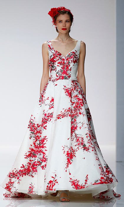 Red wedding gowns are increasingly in demand – here's a beautiful floral take, in a traditional v-neck style with A-line skirt, in red and white from Cymbeline.