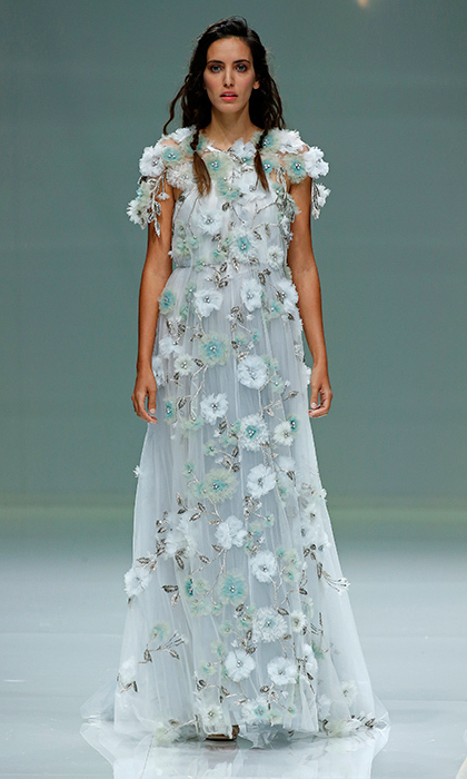Fashion house Marco & Maria presented this aquatic-meets-botanical fantasy – a dreamy goddess gown with 3D floral appliqué in blues and greens.