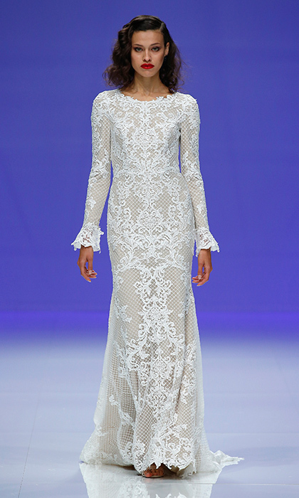 Another all-over lace look, this time by Maggie Sottero. The deceptively simple silhouette features intricately embroidered lace, with a discreet train and delicately detailed cuffs. 