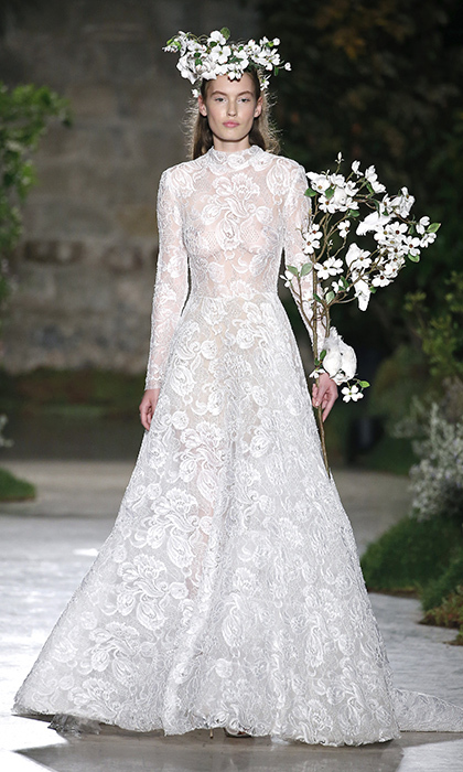 Given its sheer nature, Reem Acra's embroidered lace look shows that full coverage and long sleeves doesn't necessarily mean demure. 