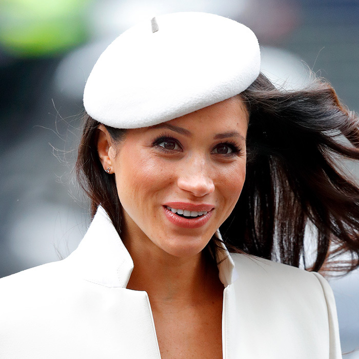A radiant Ms Markle donned this chic white beret by Stephen Jones on March 12, 2018, to the Commonwealth Day service at Westminster Abbey. 