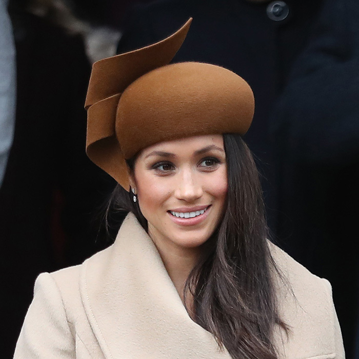 For her first Christmas with the Queen at Sandringham in 2017, Meghan chose an architectural chocolate brown hat by royal favourite Philip Treacy. Accompanied by Prince Harry at the St Mary Magdalene church service, the former actress was also joining Prince William and Kate Middleton for the first time at a royal engagement. 