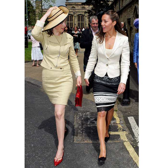 In this major throwback photo from June 2005, Kate wears a lace pencil skirt by Karen Millen and cream blazer as she chats with a fellow guest at the wedding of Hugh Van Cutsem and Rose Astor at Burford Parish Church. 