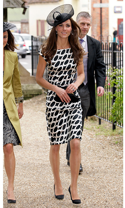 Barely two months after donning Alexander McQueen for her Westminster Abbey wedding, Kate opted for a graphic print dress from Zara, and a Lock & Company hat, for Sam Waley-Cohen and Annabel Ballin's June 2011 wedding. The ceremony was held at St Michael and All Angels church in Lambourn, England. 