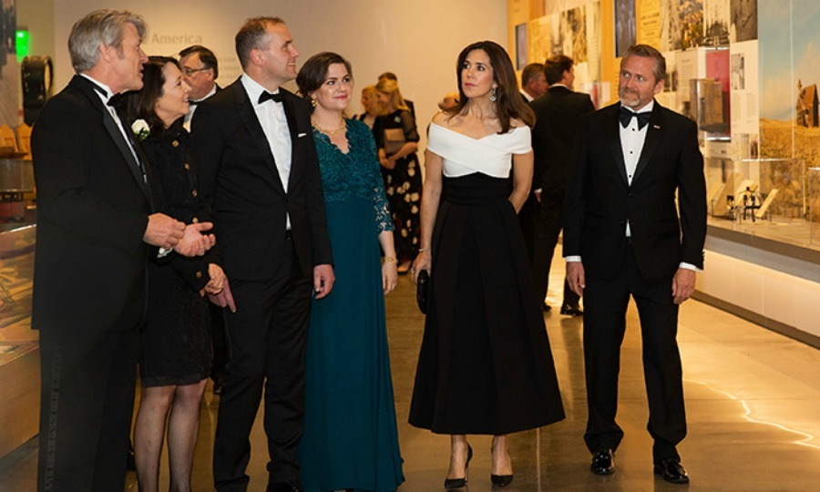 While in Washington, Denmark's Crown Princess Mary made a glamorous appearance at the Nordic Museum, where she wore a black and white evening dress that featured a stunning criss-crossed off-the-shoulder bodice. The mother-of-four joined Executive Director Eric Nelson, US Senator Maria Cantwell, President of Iceland Gudni Th. Johannesson, Iceland First Lady Eliza Reid and Denmark Foreign Minister Anders Samuelsen on a tour of the space on May 4.