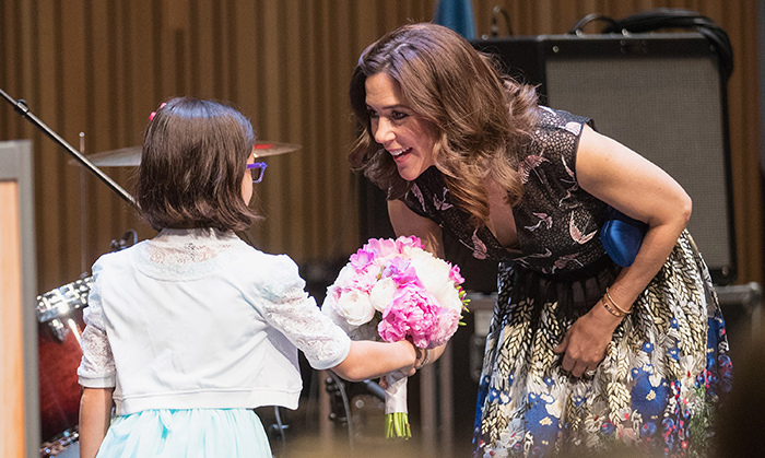 Crown Princess Mary of Denmark accepted a pretty pink and white bouquet from a young girl in Seattle during the Danish launch party for a United States-based nationwide cultural campaign at The Nordic Museum on May 3. She also enjoyed a performance by Danish band Baby in Vain. 