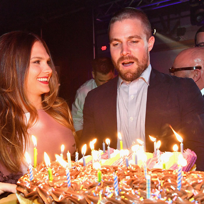 Stephen Amell, who attended with his wife Cassandra Jean, was surprised with a birthday cake and engraved bottle of Gran Patron at the Fillies and Stallions party in Louisville, Kentucky.