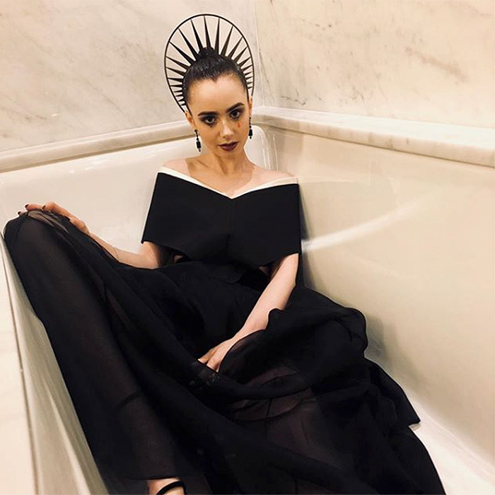 "In this quirky Instagram shot, actress Lily Collins posed the question: ""Tell me the truth: should I stay in and take a bath or go out to the after party?""