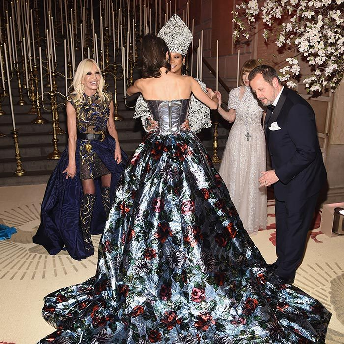 With their dramatic outfits, guests at the Met Ball have to carefully navigate the stairs – and also the hugs! Amal Clooney gave Rihanna a careful embrace as two very amused onlookers – Donatella Versace and Anna Wintour – looked on.