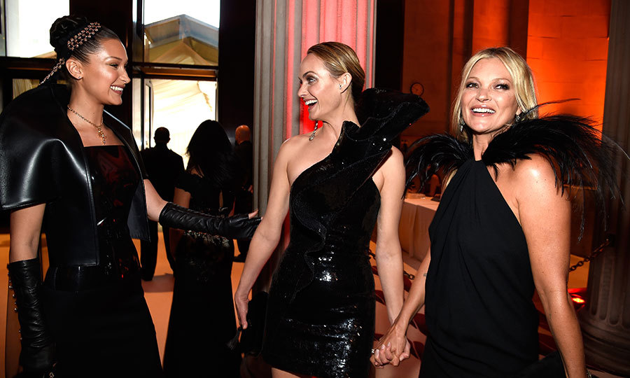 Bella Hadid, Amber Valletta and Kate Moss had a model moment in their not-so-little black dresses during the Heavenly Bodies: Fashion & The Catholic Imagination gala.