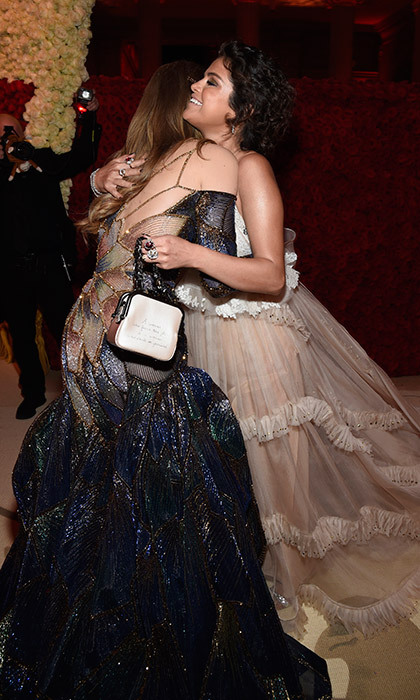 Selena Gomez and Gigi Hadid looked thrilled to see one another, melting into this taffetta-laden hug during the Met Gala cocktail party. 