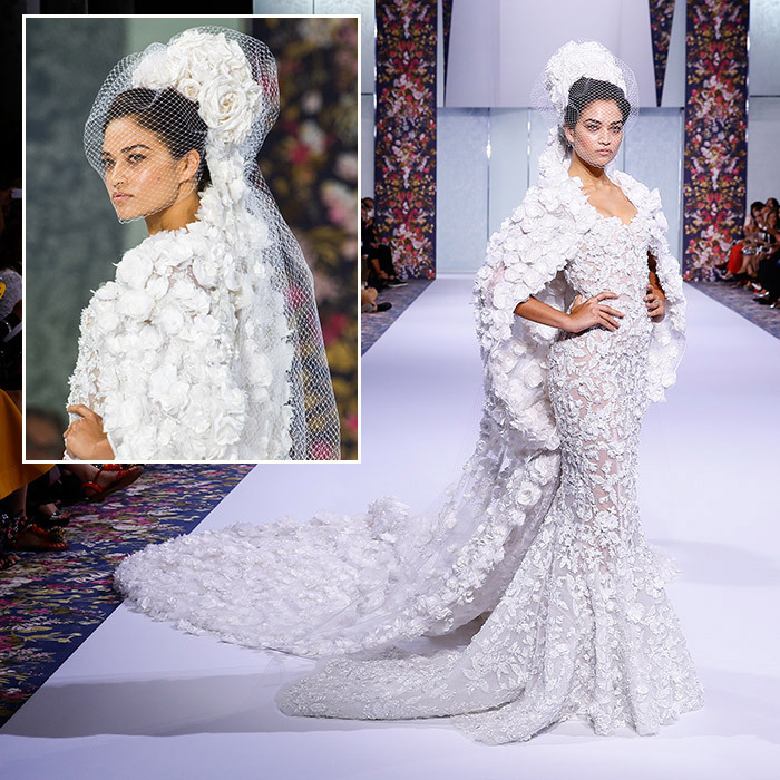 Shanina Shaik showed off a stunning white tulle Ralph & Russo fishtail wedding dress at the nature-inspired fall-winter 2016-2017 show. We love the silk organza and feather flower appliqué cape, and the veil embellished with taffeta flowers, crystals and pearls.