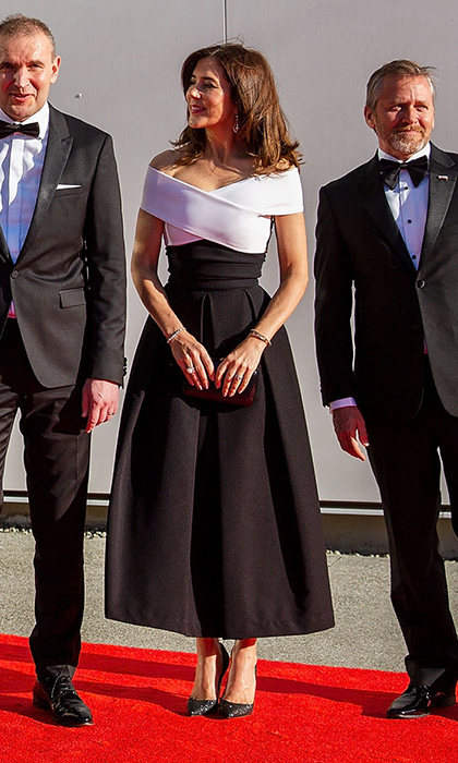 Crown Princess Mary donned an off the shoulder dress by Preen on a visit to Seattle, Washington, where she helped open the brand new Nordic Museum.