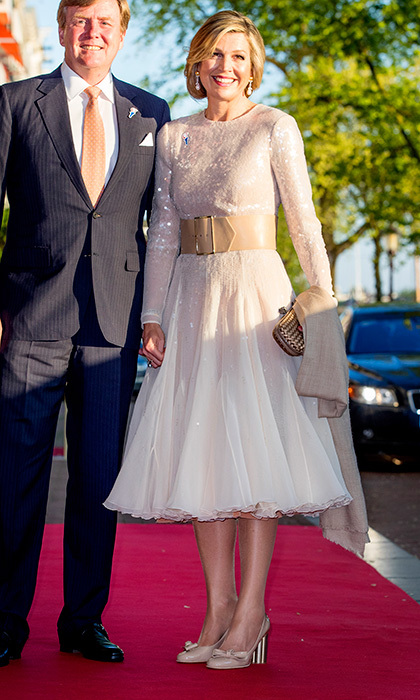 Joined by husband King Willem-Alexander, Queen Maxima of the Netherlands wore a sparkling white dress cinched at the waist with an oversized belt for a concert on the Amstel in Amsterdam.