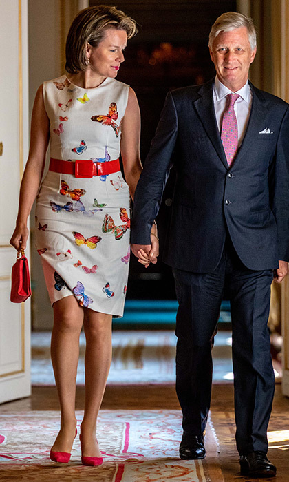 Holding hands with husband King Philippe of Belgium, Queen Mathilde was ready for spring in butterfly print dress before a lunch held in the Royal Palace in Brussels on May 9.