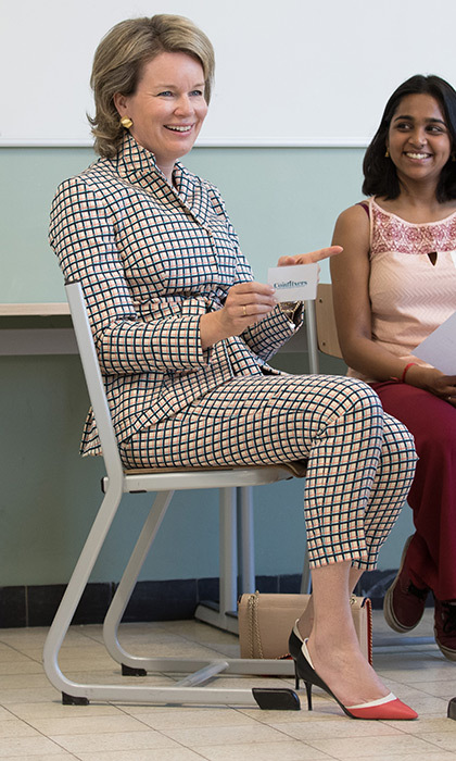 Do you have one of spring's hottest trends in your wardrobe? Check! Queen Mathilde of Belgium wore a coordinated checkered suit during a visit to the Maria Boodschap Lyceum, a Catholic school for secondary education, in Brussels on May 8.