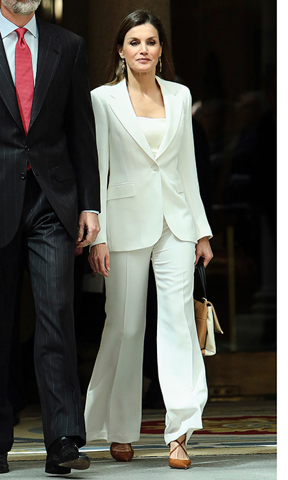 Queen Letizia of Spain was ready for business in a white wide-legged suit at the presentation of the BDE (Electronic Biographical Dictionary) at El Pardo Palace in Madrid.