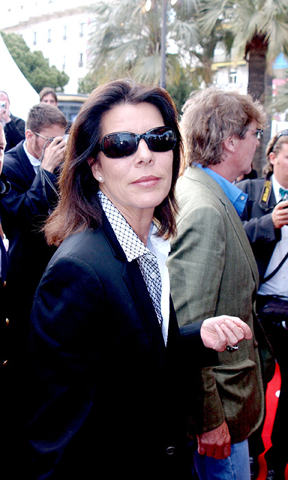 The one must-have accessory in Cannes is movie star shades! Princess Caroline of Monaco wore her dark sunglasses on the red carpet for the 'Fahrenheit 911' premiere at Palais Du Festival in 2004.