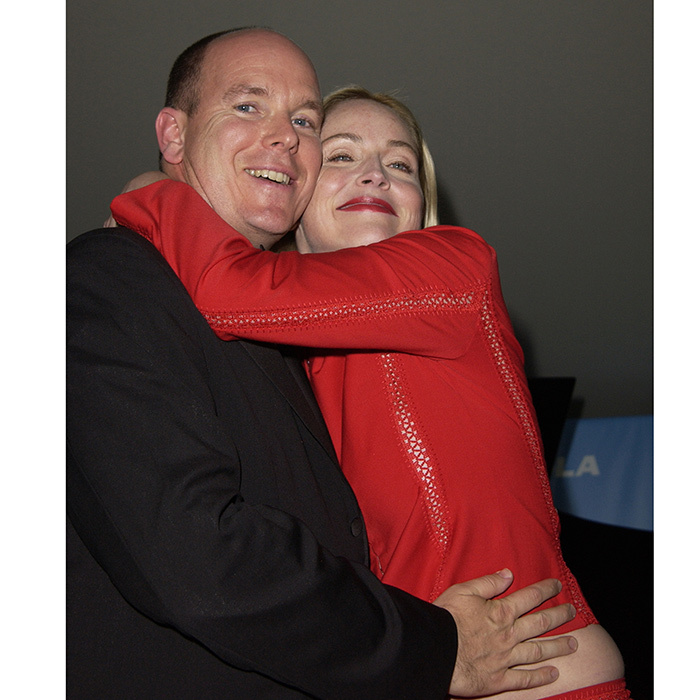 Hugs all around! Prince Albert II and Sharon Stone got up close and personal at amfAR's Cinema Against AIDS Gala sponsored by Motorola and co-sponsored by De Beers in 2002.