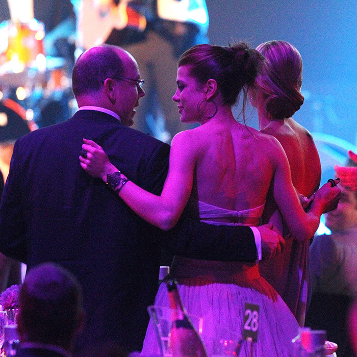 A candid moment from Charlotte Casiraghi and her uncle, Prince Albert II of Monaco. The two were dancing at the amfAR Cinema Against AIDS Gala during the 64th Annual Cannes Film Festival at Hotel Du Cap in 2011.