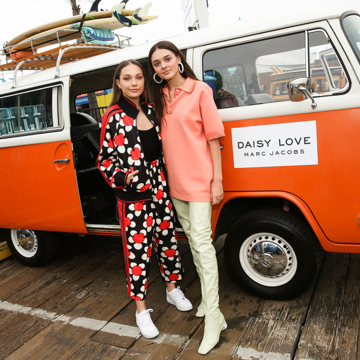 Maddie Ziegler and Charlotte Lawrence had a vintage ride as they celebrated the new Marc Jacobs fragrance, Daisy Love, at the Santa Monica Pier.