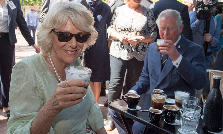 Taking a coffee break? Prince Charles and Camilla visited a local cafe during a walking tour of central Athens during their royal visit to Greece on May 10.