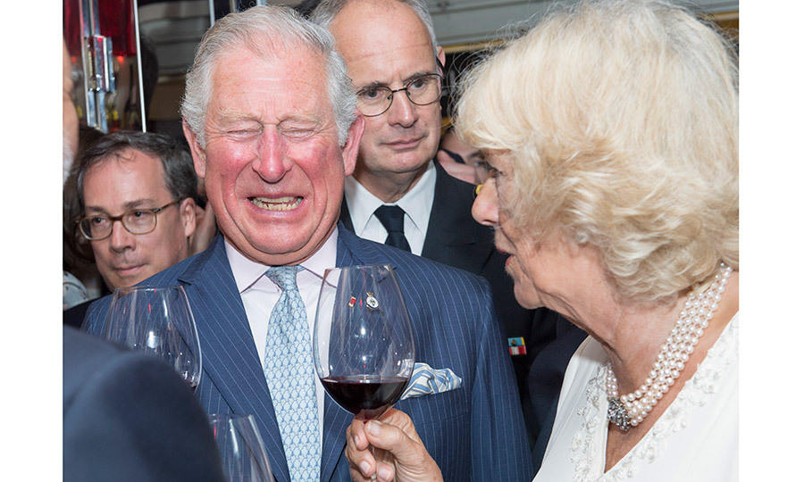 Cheers! The royal couple shared a toast with some red wine as they enjoyed a tour of Les Halles de Lyon-Paul Bocuse food market in Lyon, France, on May 8. 