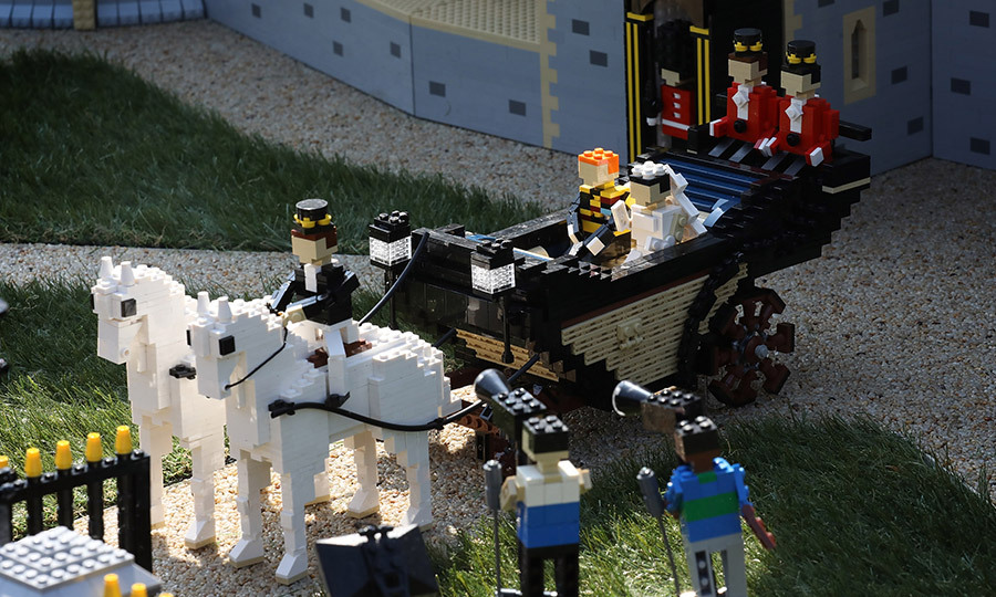 Royal weddings are child's play! Or that's how it appears given a look at this model of Windsor Castle celebrating Prince Harry and Meghan Markle's May 19 nuptials. The display, which includes Lego versions of the whole royal family as well as The Spice Girls and Elton John, can be seen at England's LEGOLAND Windsor.