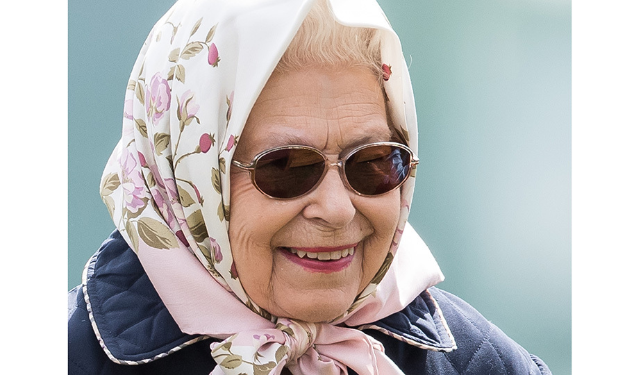 Queen Elizabeth II wore one of her signature scarves for Day 3 of the Royal Windsor Horse Show in Windsor, the town where grandson Prince Harry will wed Meghan Markle on May 19. The annual horse show is held in the private grounds of Windsor Castle.
