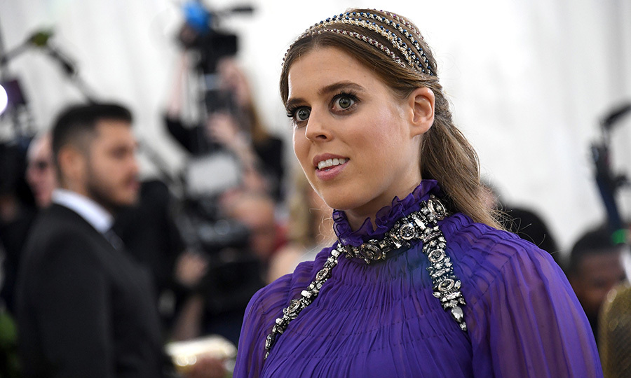 Princess Beatrice wore regal purple to the 2018 Met Gala in New York City, accessorising her Alberta Ferretti goddess gown with a beautiful sparkling headband.
